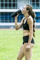 Girl athlete drinking water