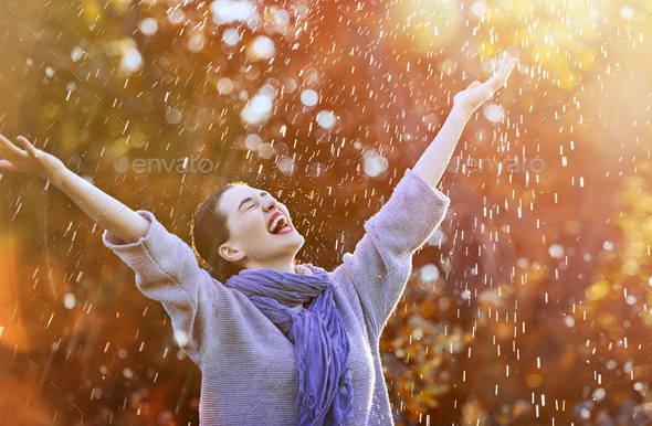 woman under the autumn shower - Stock Photo - Images