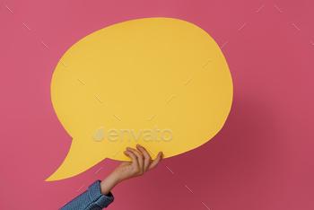 Hand with cartoon speech