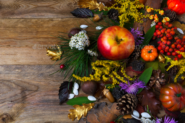 Fall decoration with flowers and apple on wooden table - Stock Photo - Images