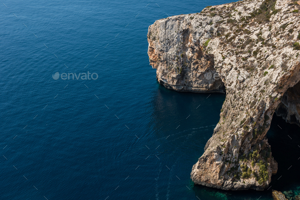 Blue grotto cave in Malta. Natural limestone arch over a lagoon - Stock Photo - Images