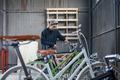 Craftsman looking at bicycles