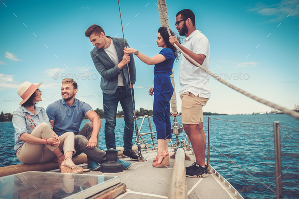 Happy friends resting on a yacht - Stock Photo - Images