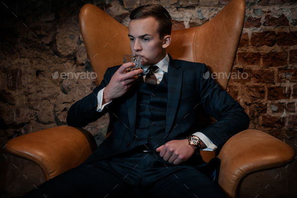 Sharp dressed dandy in a chair - Stock Photo - Images