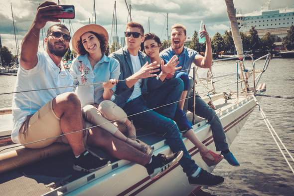 Happy friends taking selfie on a yacht - Stock Photo - Images