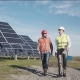 Workers Walking in Between Rows of Solar Panels - VideoHive Item for Sale