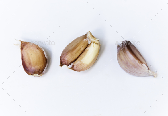 Closeup of garlic cloves on white background - Stock Photo - Images