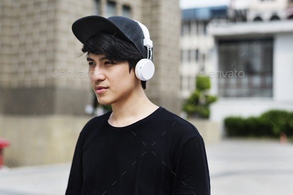 Asian Guy Listen to Music Headphones - Stock Photo - Images
