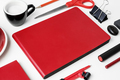 Closeup of red stationery on white table