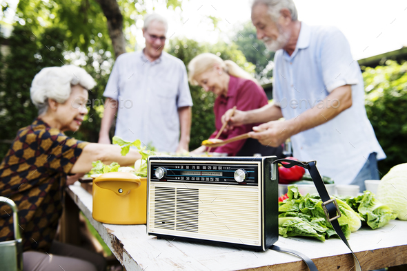 Closeup of retro classic radio on wooden cooking table - Stock Photo - Images