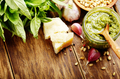 Top view of Pesto sauce and ingredients on wood table with copy-
