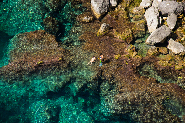 Aerial above view of a couple bathing in the sea - Stock Photo - Images