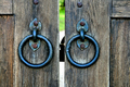 ancient wooden gate with door knocker rings - PhotoDune Item for Sale