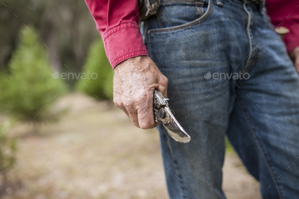 weathered hands holding pruning shears - Stock Photo - Images