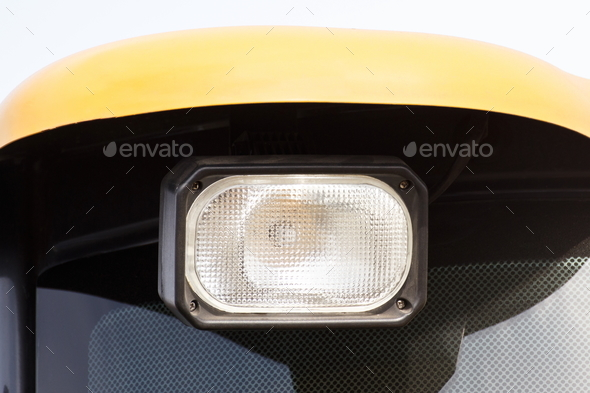 Front light of car, tractor or agricultural machine - Stock Photo - Images