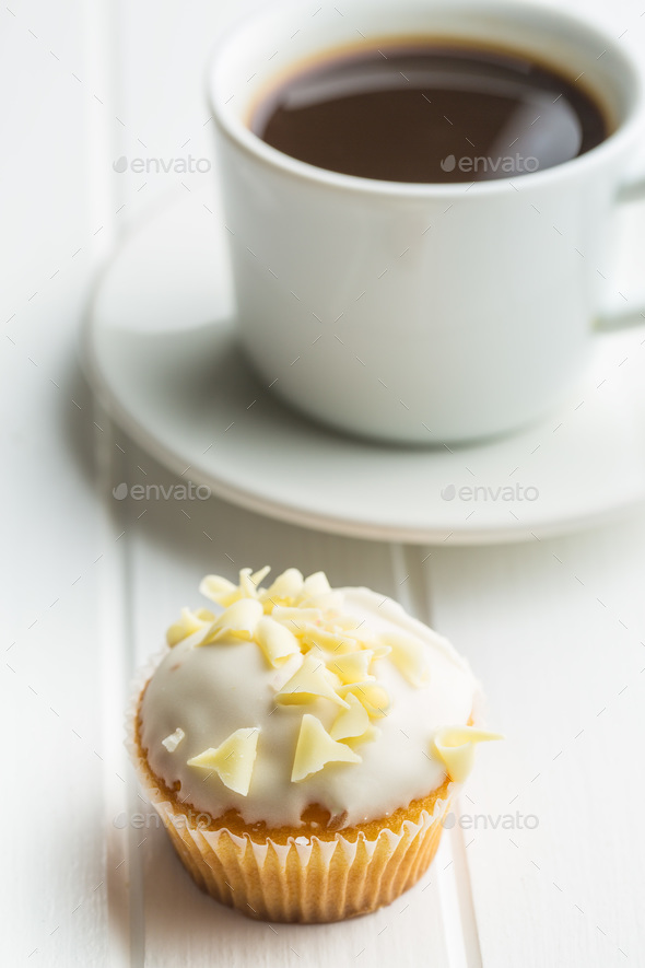 Tasty cupcake and coffee cup. - Stock Photo - Images