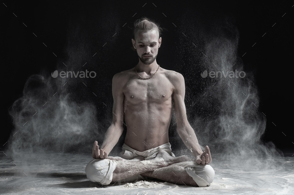 Padmasana with palms in mudra - Stock Photo - Images