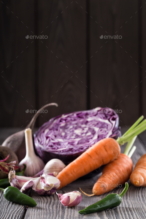 Raw vegetables on a wooden table - Stock Photo - Images