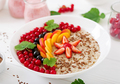 Tasty and healthy oatmeal porridge with berry, flax seeds and smoothies