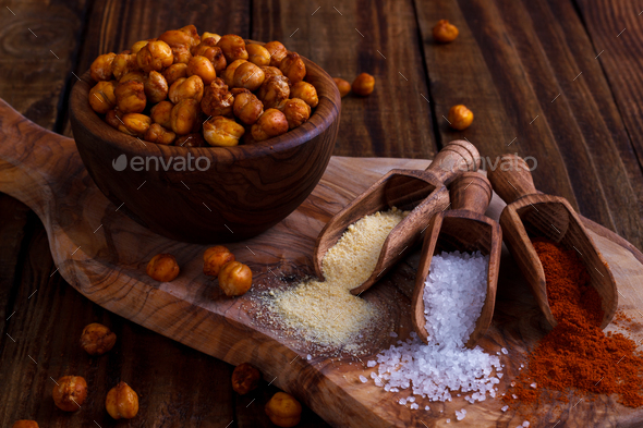 Roasted spicy chickpeas on rustic background - Stock Photo - Images