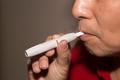 Smoker smoking hybrid smokeless cigarette device that uses real