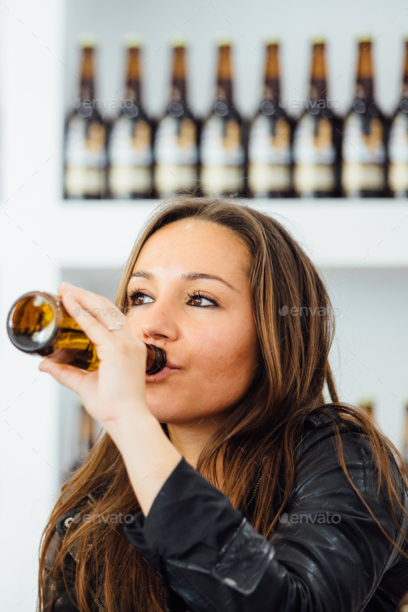 Woman drinking bottle beer Stock Photo by Click_and_Photo ...