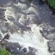 Rising Aerial Shot Looking Down at Raging Waterfall in a River - VideoHive Item for Sale