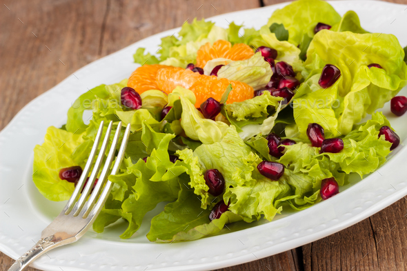 Healthy salad with pomegranate and mandarins - Stock Photo - Images