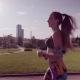 Young Fitness Woman Running in City Park