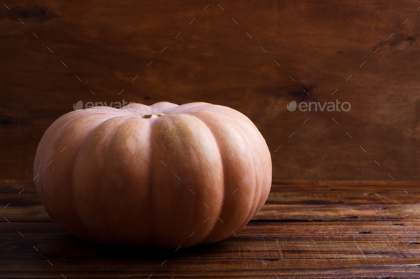 Big pumpkin on wooden background - Stock Photo - Images