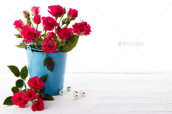 Pink Roses in a backet - Stock Photo - Images