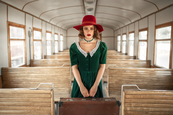 Woman with suitcase in retro train, old wagon - Stock Photo - Images