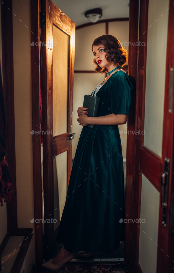 Old-fashioned woman travels, retro train - Stock Photo - Images