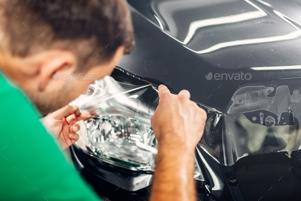 Specialist install car paint protection film - Stock Photo - Images