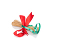 Bone Christmas gift wrapped with green and red ribbon