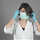 Female Surgeon in Green Gloves Getting Ready for Operation, Putting Mask On - VideoHive Item for Sale