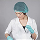 Young Female Doctor in Gloves Holding a Syringe and Preparing Injection Isolated on Grey Background - VideoHive Item for Sale