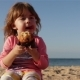 Cute Little Child Eating a Cupcake and Drinks Water From a Bottle - VideoHive Item for Sale