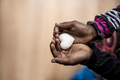 Closeup of African-American girl holding a marble made heart sha