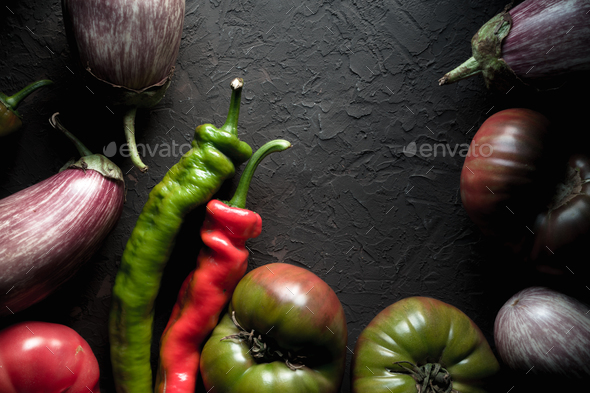 Half-frame of multi-colored eggplant, tomato and chili - Stock Photo - Images