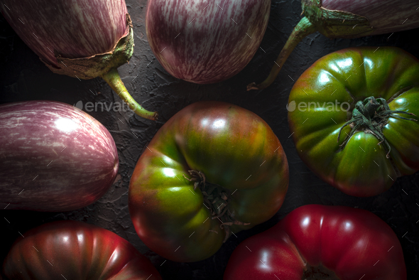 Background of large colored tomatoes and aubergines - Stock Photo - Images