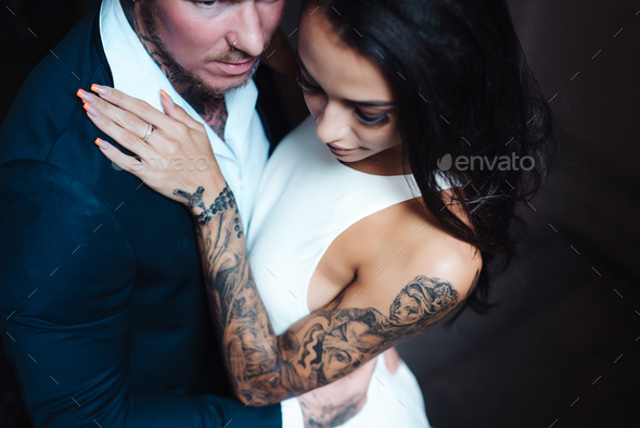 Beautiful, young couple posing on camera indoors - Stock Photo - Images