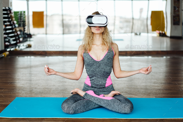 Woman in yoga class with VR headset - Stock Photo - Images
