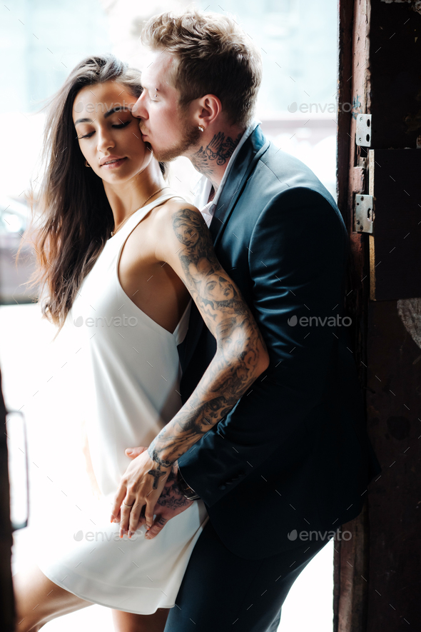 couple posing in the doorway - Stock Photo - Images