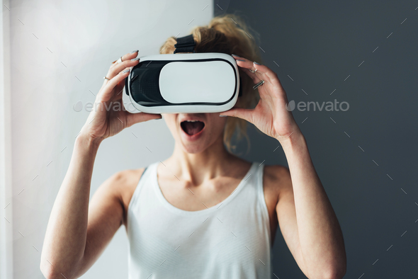 Woman in VR headset looking up - Stock Photo - Images