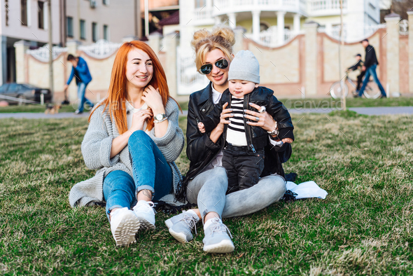 Mom and aunt play with a boy in the Park - Stock Photo - Images