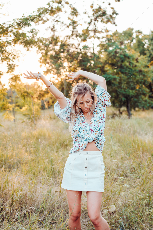 Girl posing against nature background - Stock Photo - Images