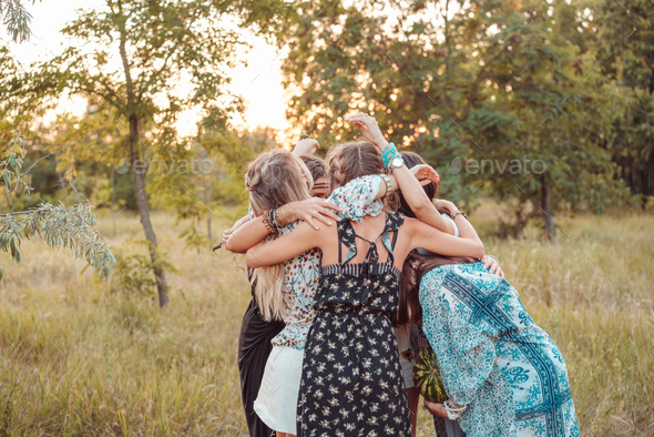 Girls stand in a circle embracing each other - Stock Photo - Images