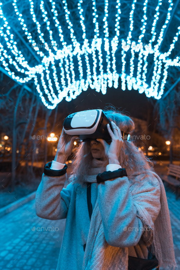 Young girl getting experience VR headset - Stock Photo - Images