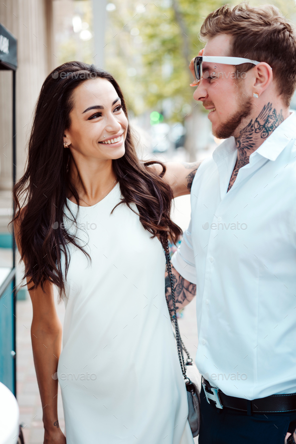 Girl and handsome guy outdoors - Stock Photo - Images